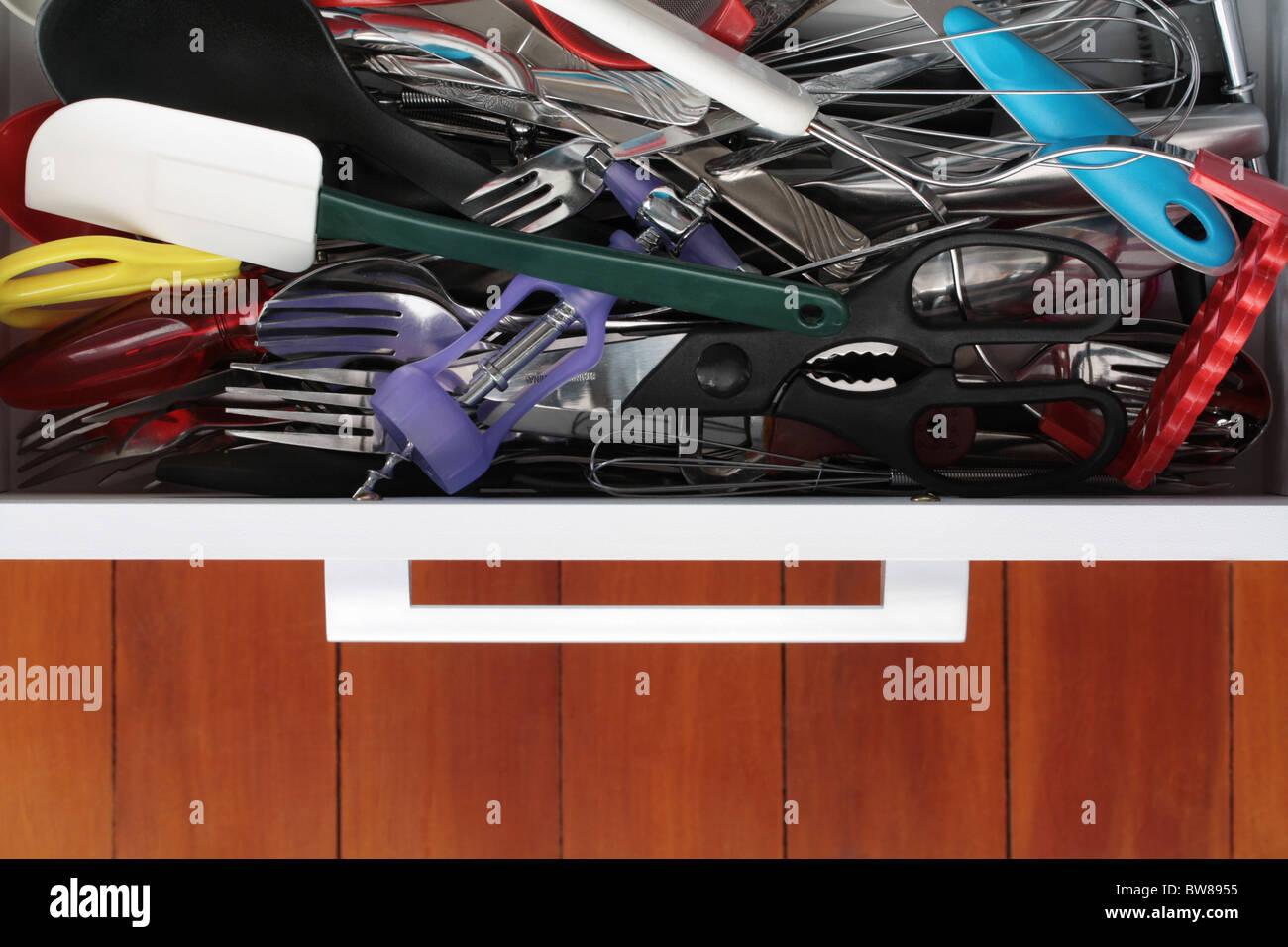 Kitchen Drawer Crammed full of Utensils - Stock Image