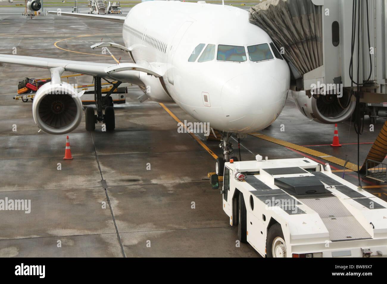 Airport Aeroplane & Airbridge - Stock Image
