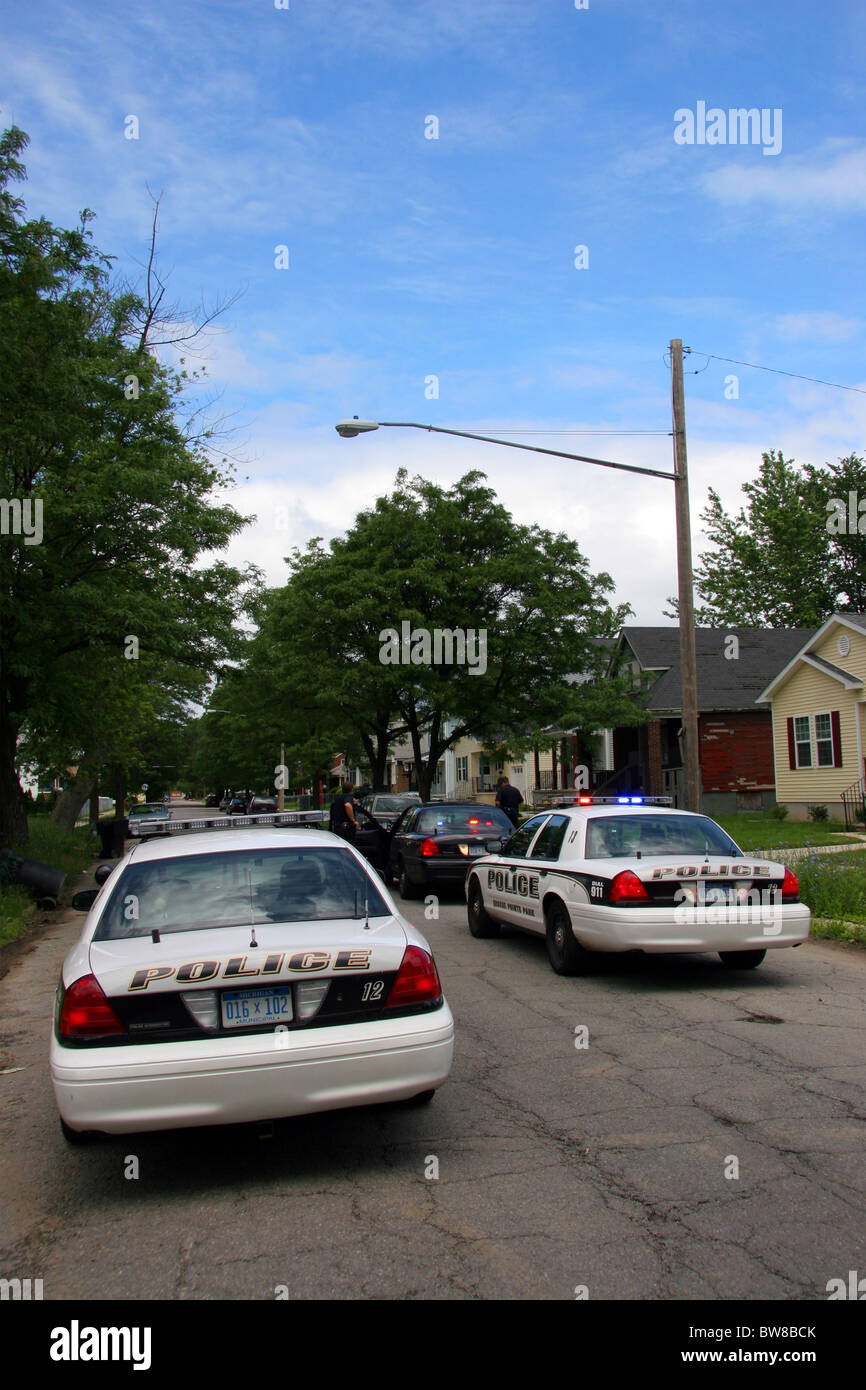 Grosse Pointe Park police squad cars cross the border into Detroit. - Stock Image