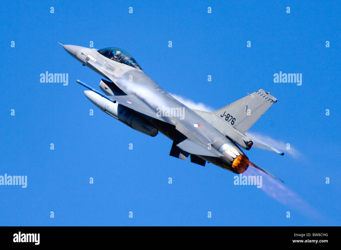 F-16AM Fighting Falcon jet fighter operated by the Royal Netherlands Air Force climbing with full afterburner after - Stock Image