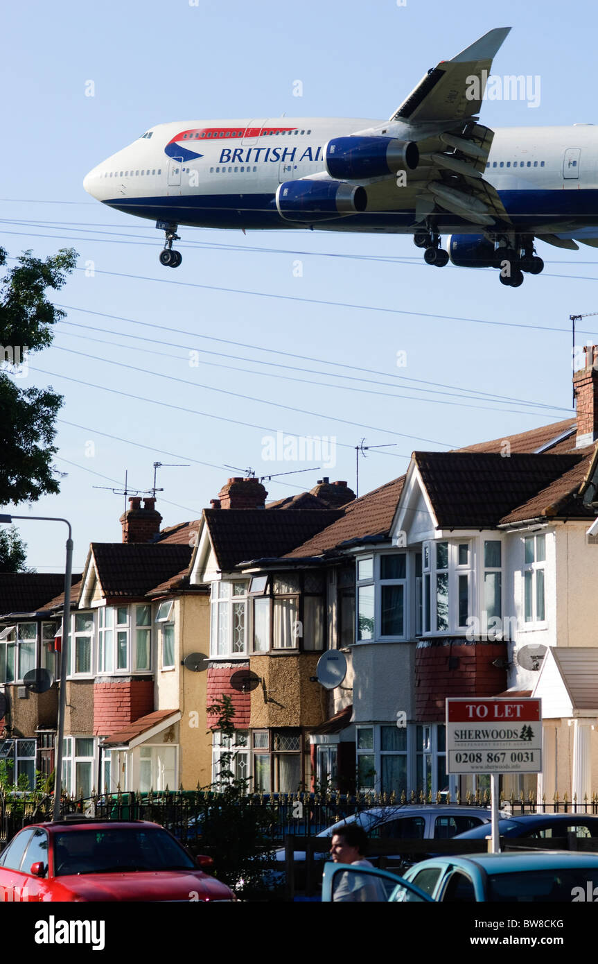 Heathrow runway approach by Boeing 747 British Airways plane  landing at London Heathrow Airport, UK. Myrtle Avenue - Stock Image
