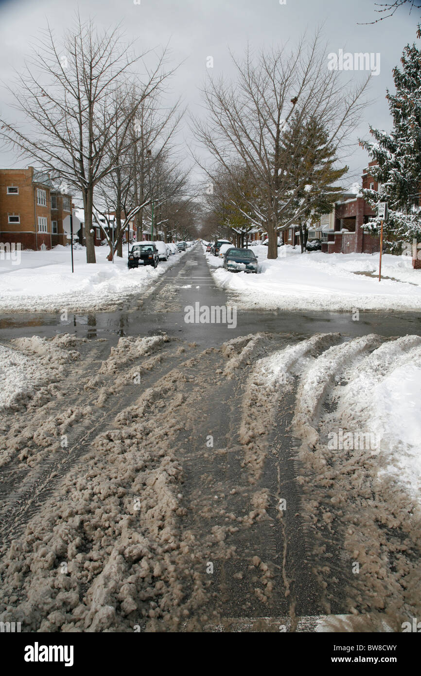Dirty Wet Snow And Tire Tracks On A Plowed City Side