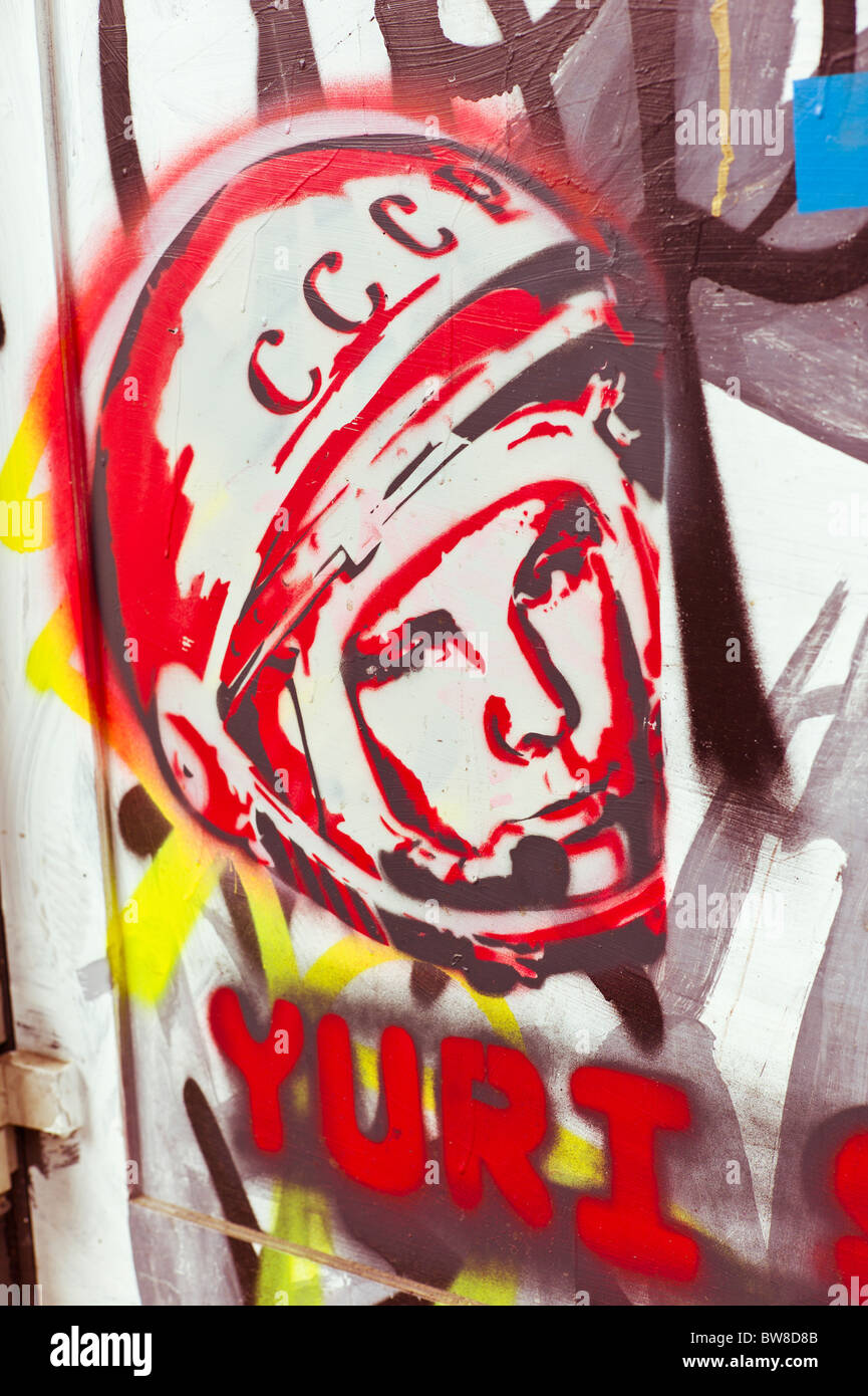 Graffiti showing the head of the Soviet cosmonaut Yuri Gagarin wearing a helmet with CCCP written on it, Berlin, - Stock Image