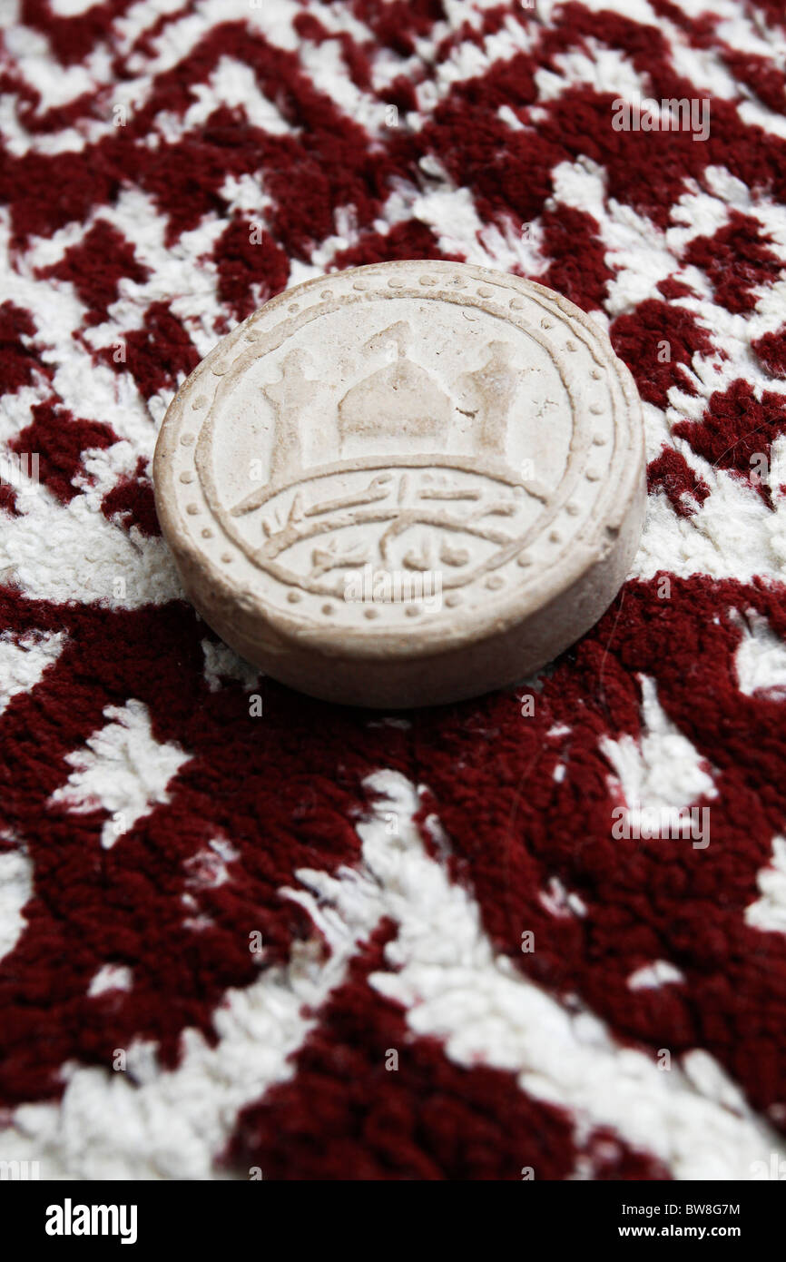 Turba - prayer stone used by Shiite Muslims. - Stock Image
