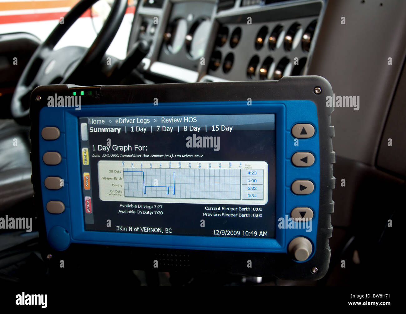 An electronic logbook for truck drivers keeps track of the hours of service. - Stock Image