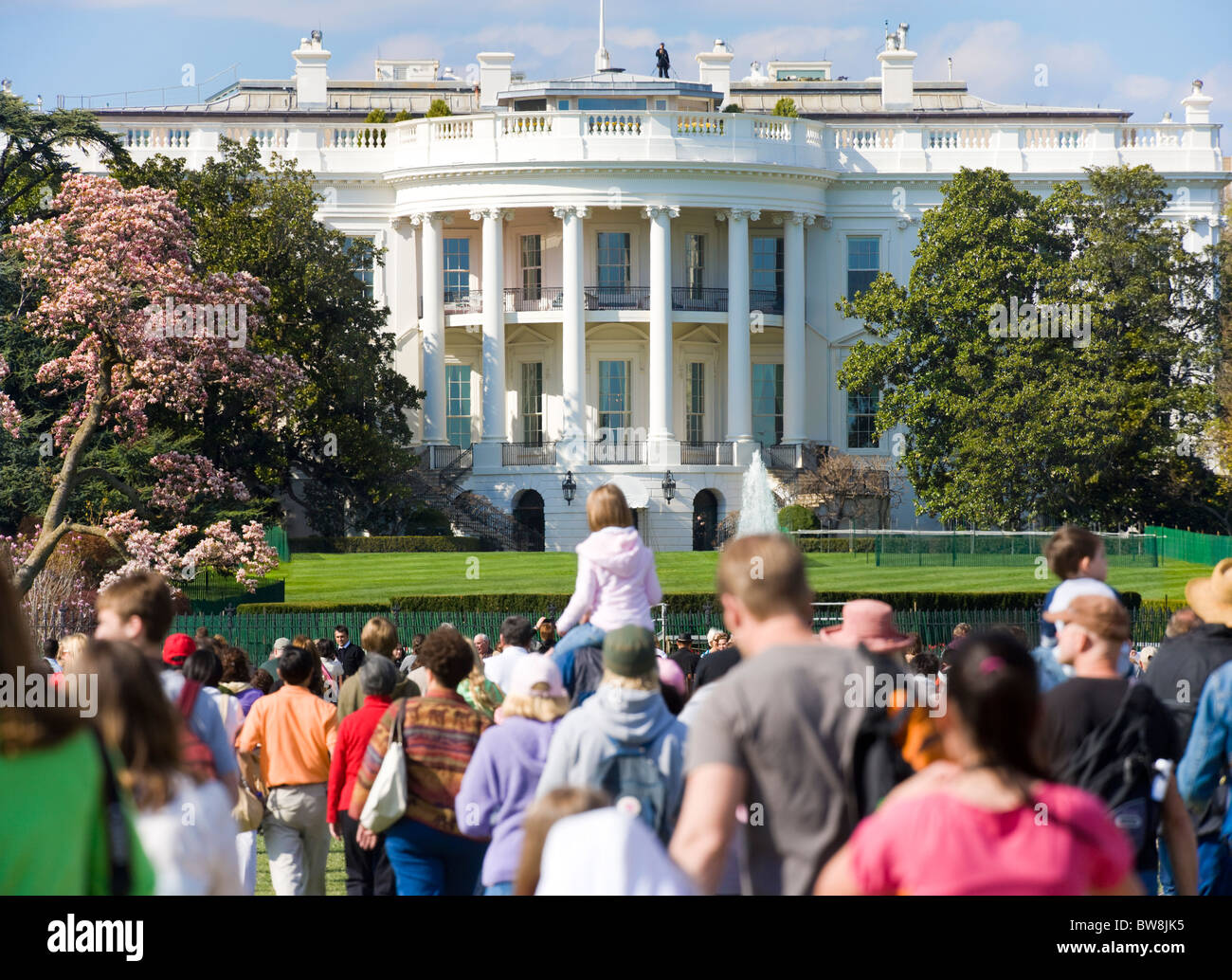 Crowds of tourists looking at the south side of The White House from the Ellipse in spring. Washington DC D.C. USA - Stock Image