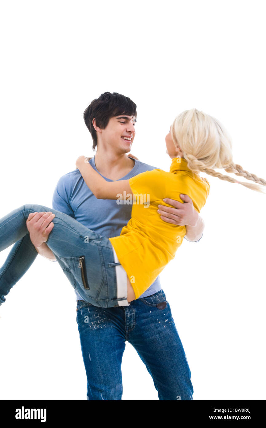 Image of handsome man holding his girlfriend and both laughing Stock Photo