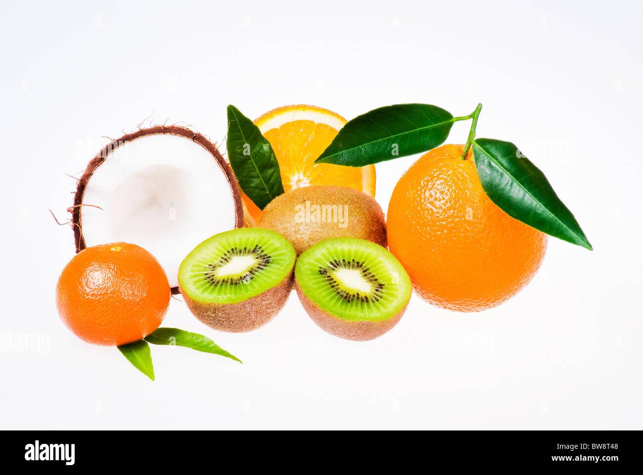 Fresh exotic fruits over white background - Stock Image