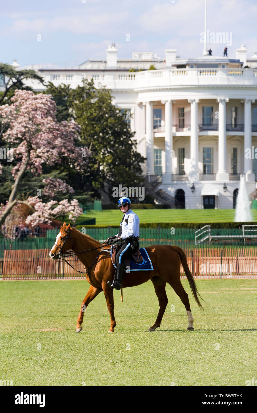 The White House Washington DC. Two Secret Service men on the roof. A Park Police Mounted Officer patrolling the - Stock Image