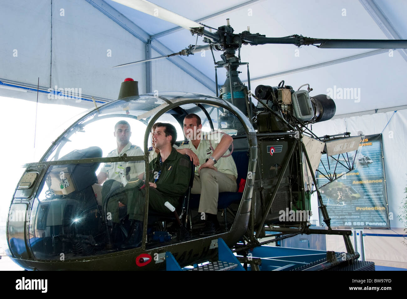 Paris, France, Trade Show, French Soldiers at Paris Air Show, the Bourget Airport, Looking at French Air Force Helicopter - Stock Image