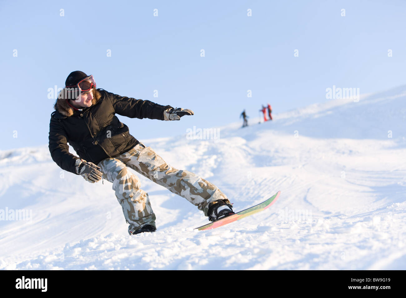 Image of sportsman go snowboarding at free time - Stock Image