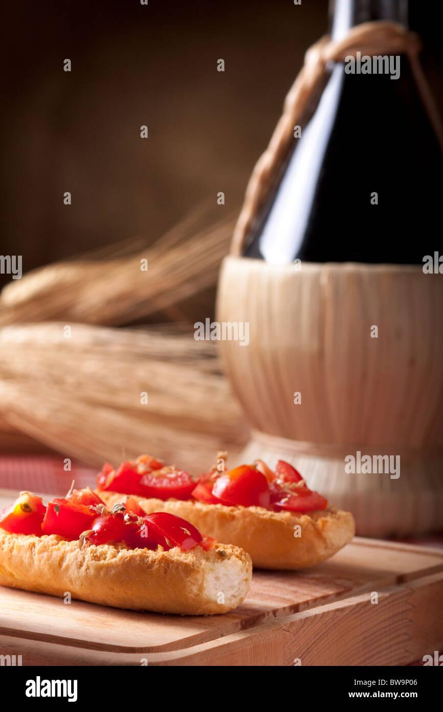 Bruschetta with Wine Flask and Wheat - Stock Image