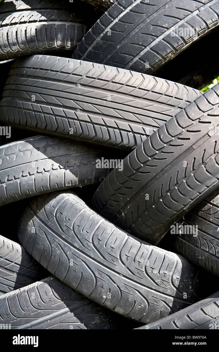Worn out car tyres. - Stock Image