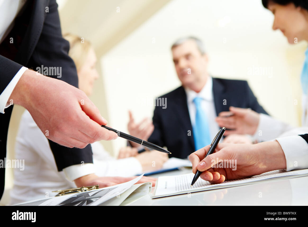 Close-up of business partners hands during discussion in working environment - Stock Image