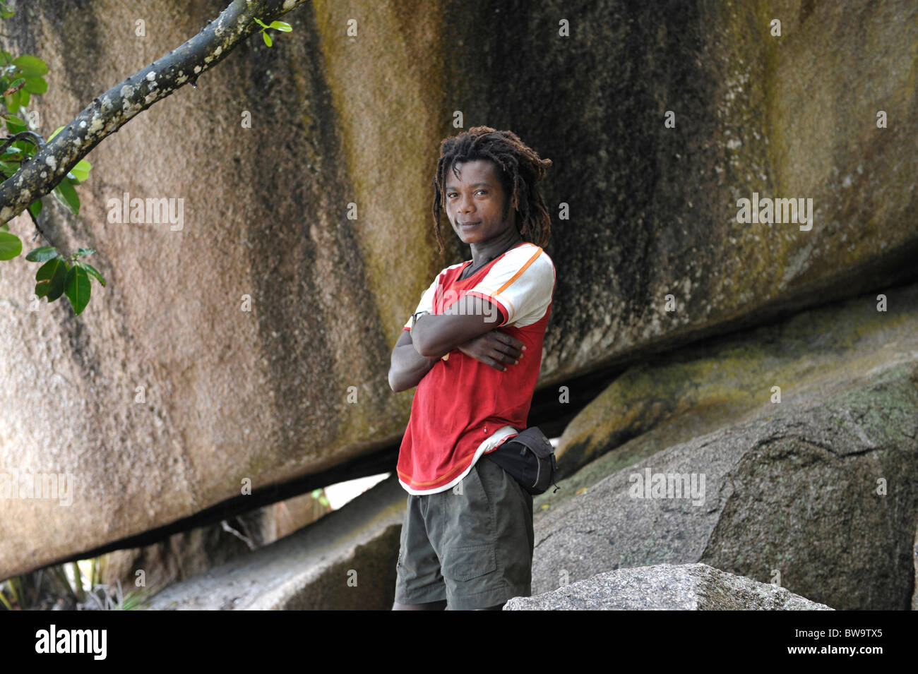 Younger dark skinned man on Grand Anse, La Digue, Seychelles - Stock Image