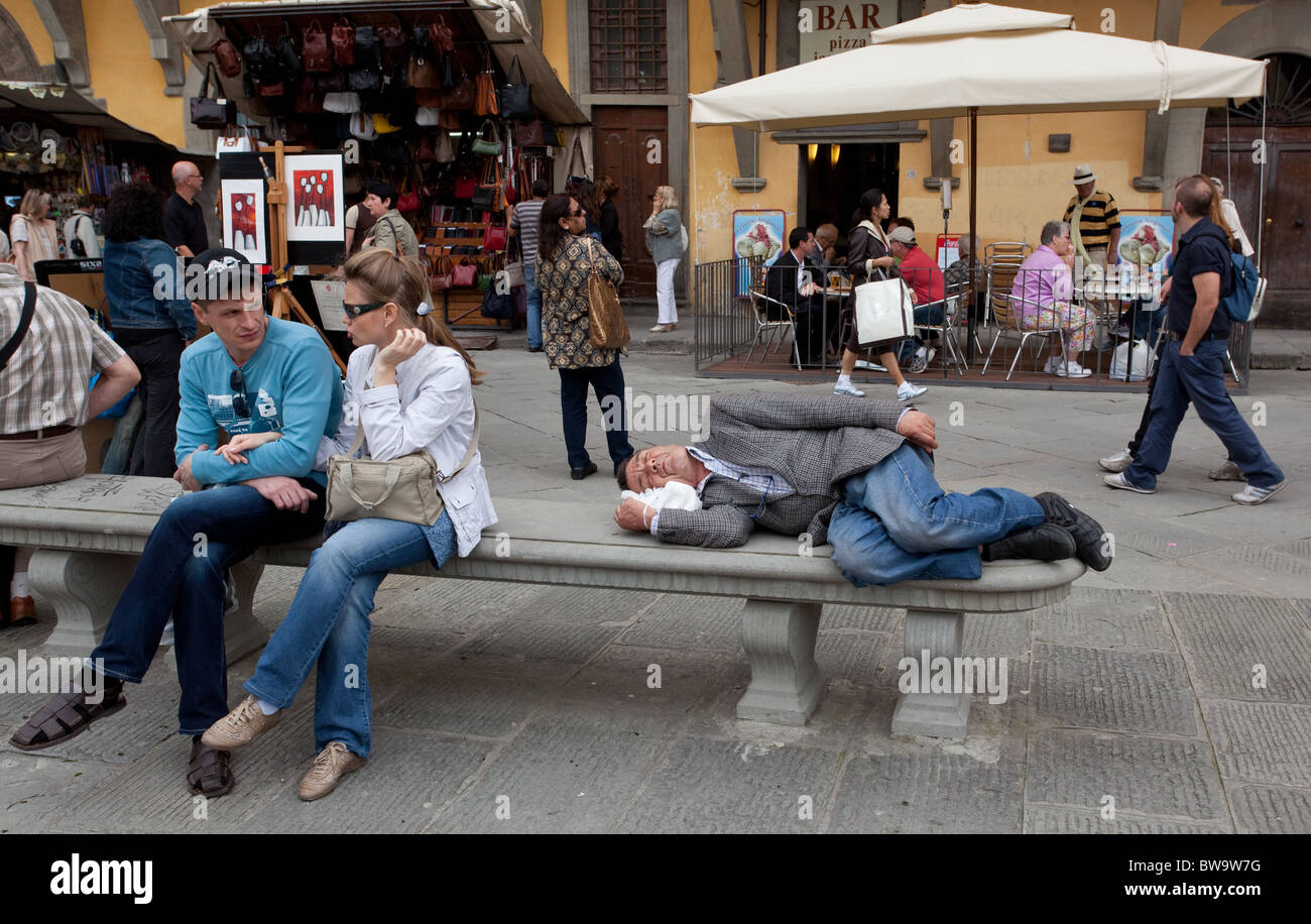 Man enjoys afternoon snooze  in Florence Italy - Stock Image