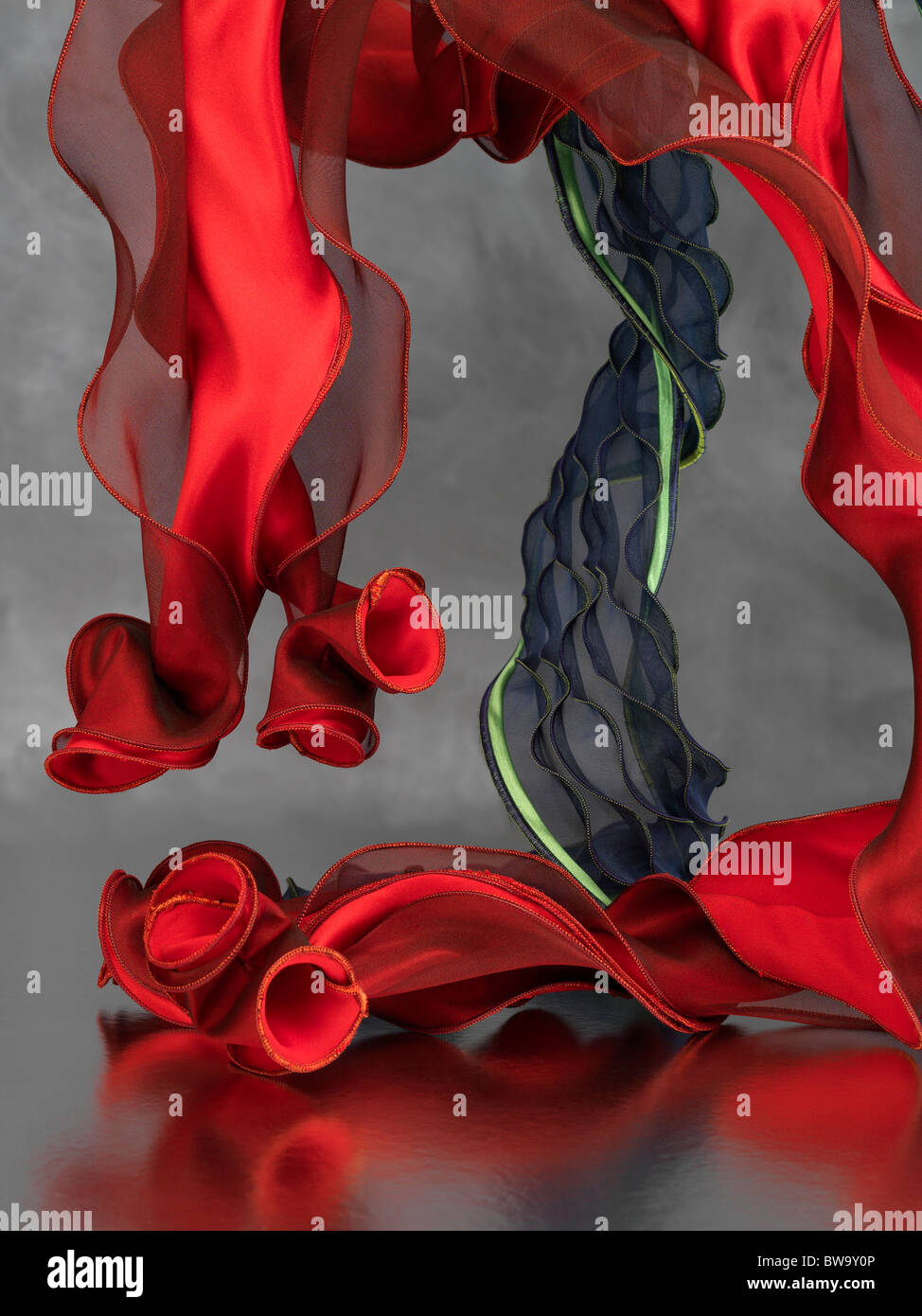Two contemporary silk scarves on a grey background - Stock Image