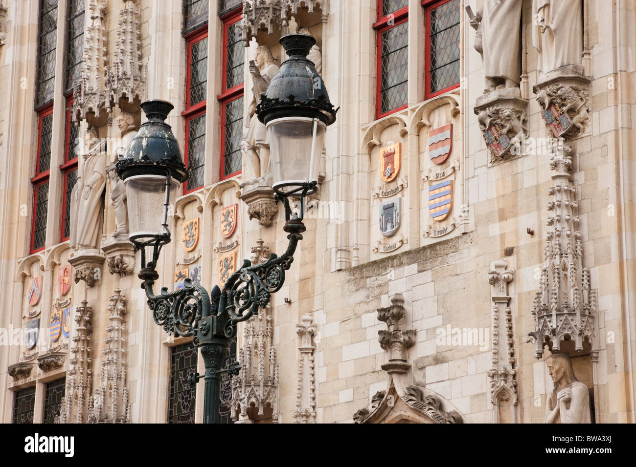 Burg Square, Bruges, East Flanders, Belgium. Lampost outside the historic Gothic Stadhuis City Hall with sandstone - Stock Image