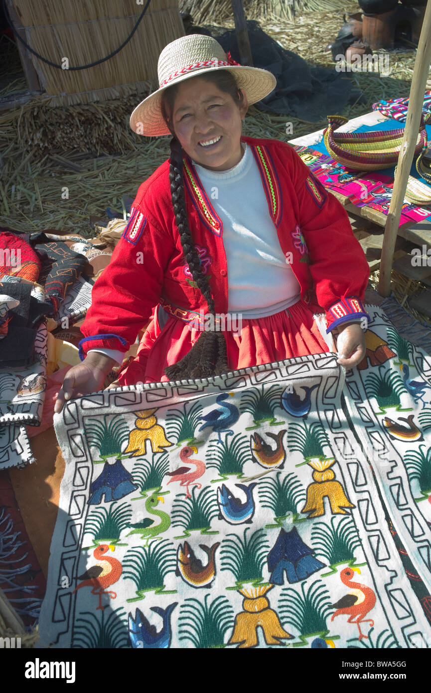 Indigenous woman selling handcrafts, Uros Island, Lake Titicaca, Peru Stock Photo