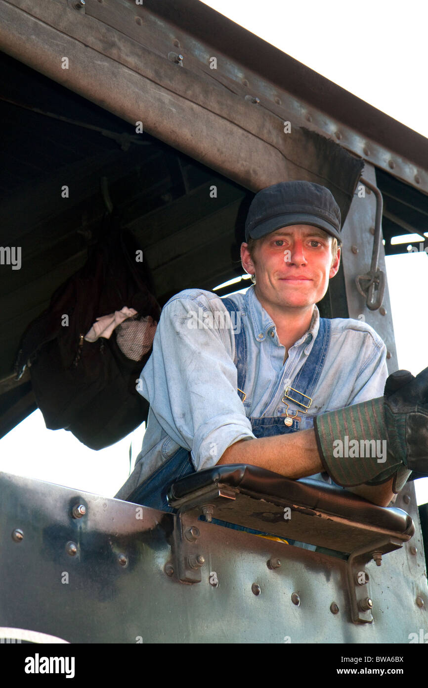 Steam locomotive engineer on the Durango and Silverton Narrow Gauge Railroad located in Durango, Colorado, USA. - Stock Image