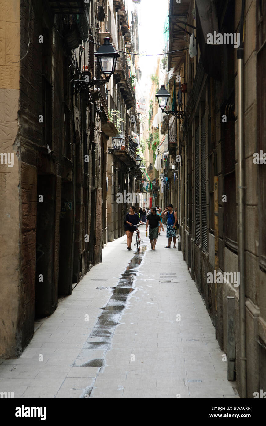 narrow alleyway in the Barrio Gotico, the old part of Barcelona, Spain - Stock Image