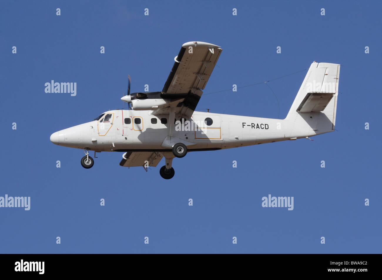 De Havilland Canada DHC-6 Twin Otter light turboprop commuter plane in flight - Stock Image