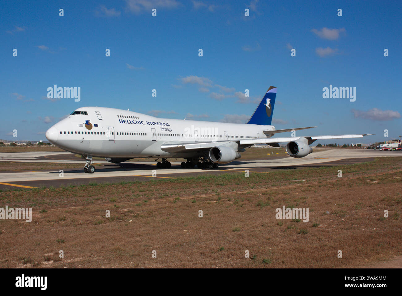 Commercial aviation. Hellenic Imperial Airways Boeing 747-200 on a taxiway at Malta International Airport shortly - Stock Image