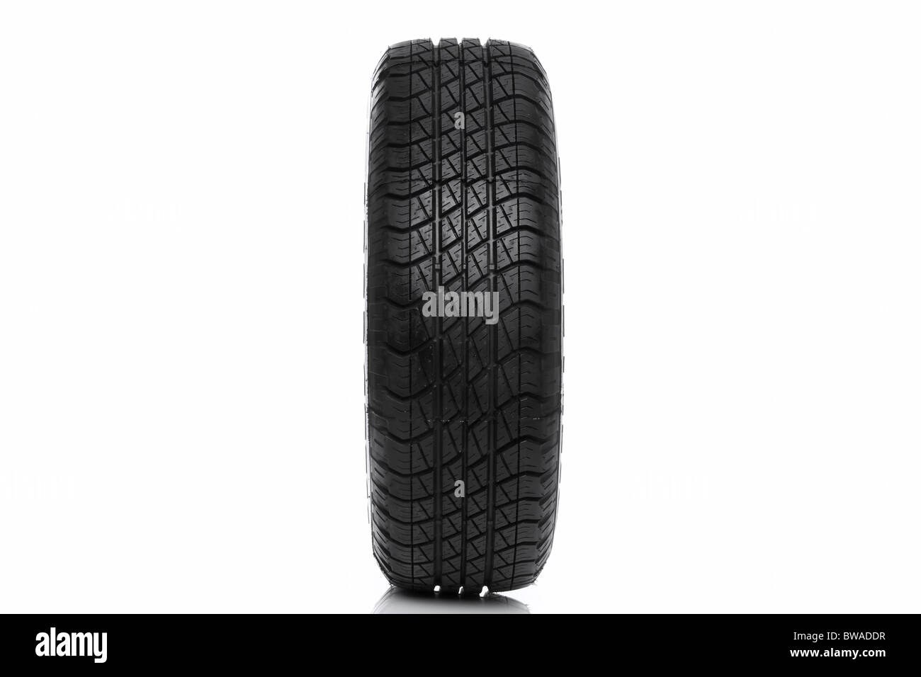 Photo of a car tyre (tire) isolated on a white background - Stock Image