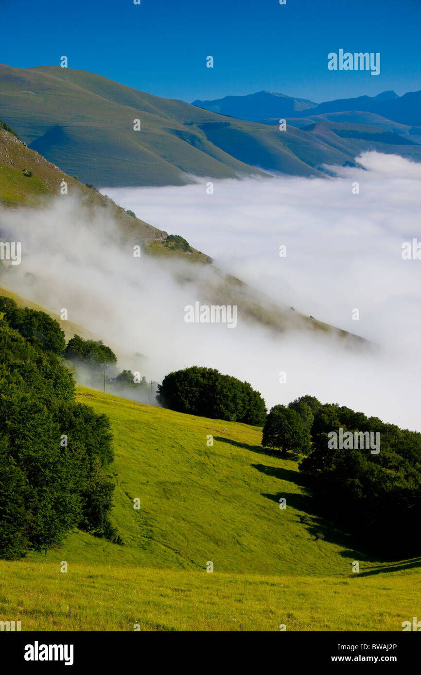 Foggy mist hangs in the Piano Grande, part of the Monti Sibillini National Park, Umbria Italy - Stock Image
