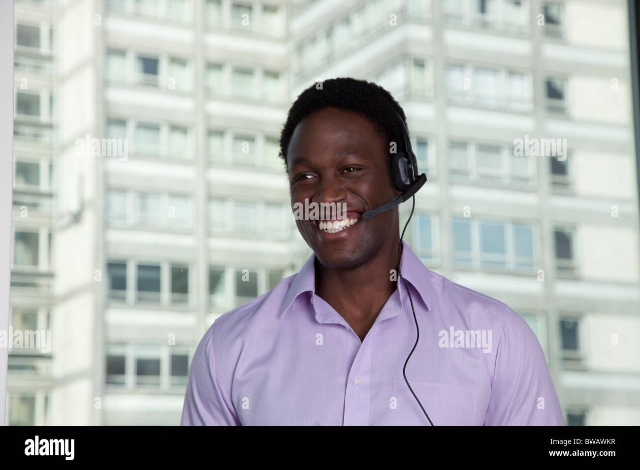 Businessman wearing phone headset Stock Photo