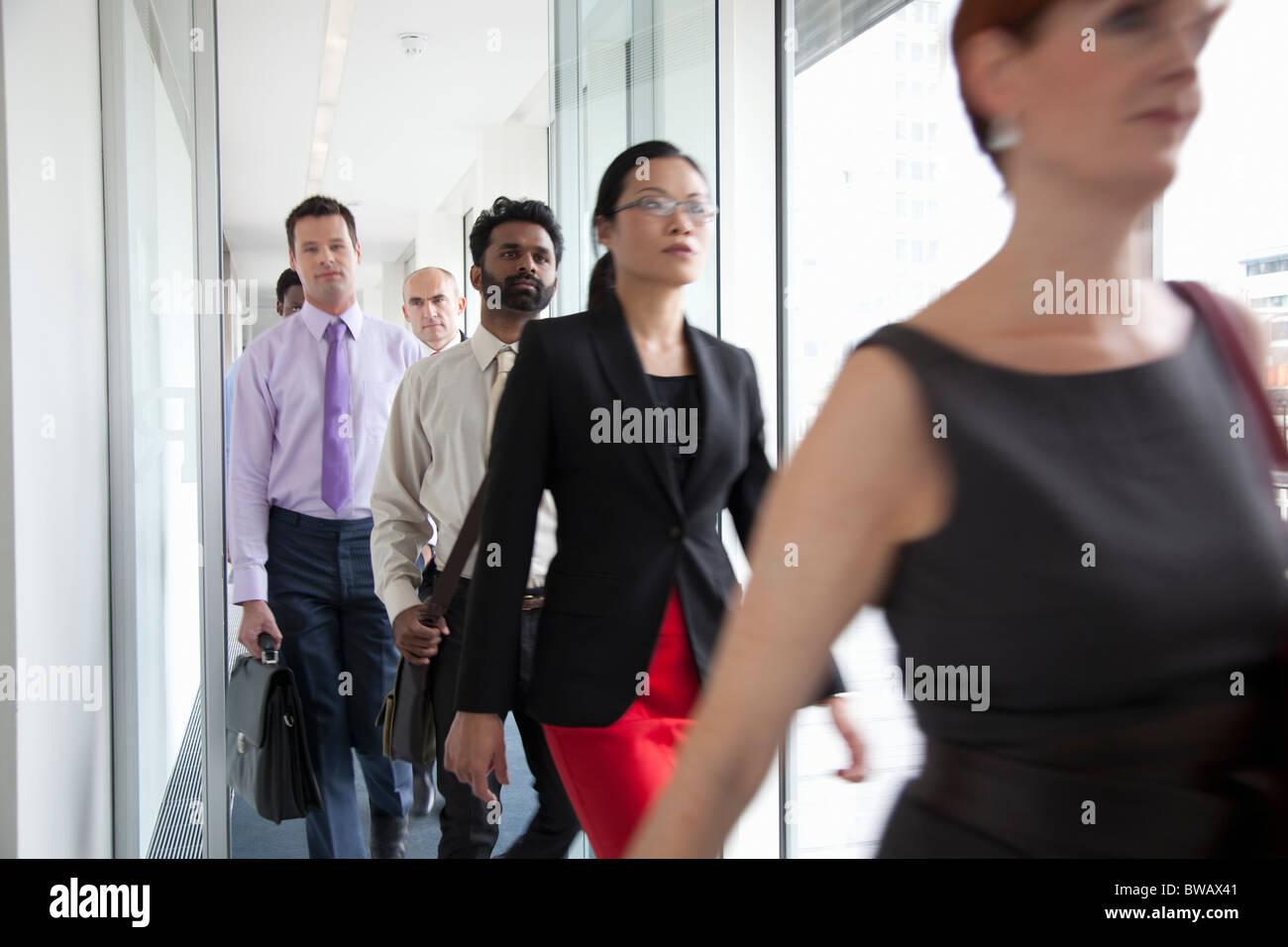 Business people rushing past camera - Stock Image