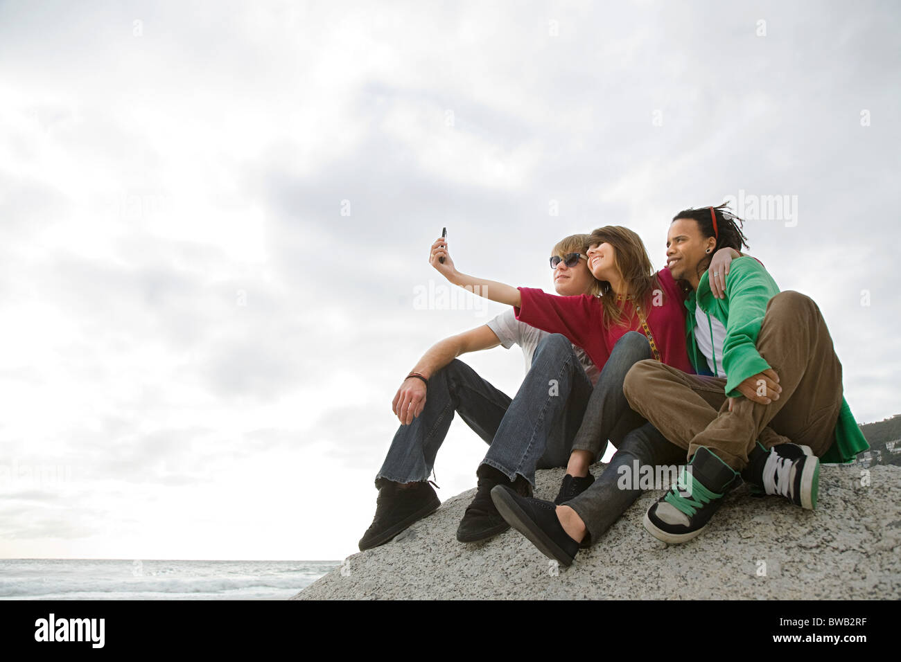 Friends taking photograph of themselves - Stock Image