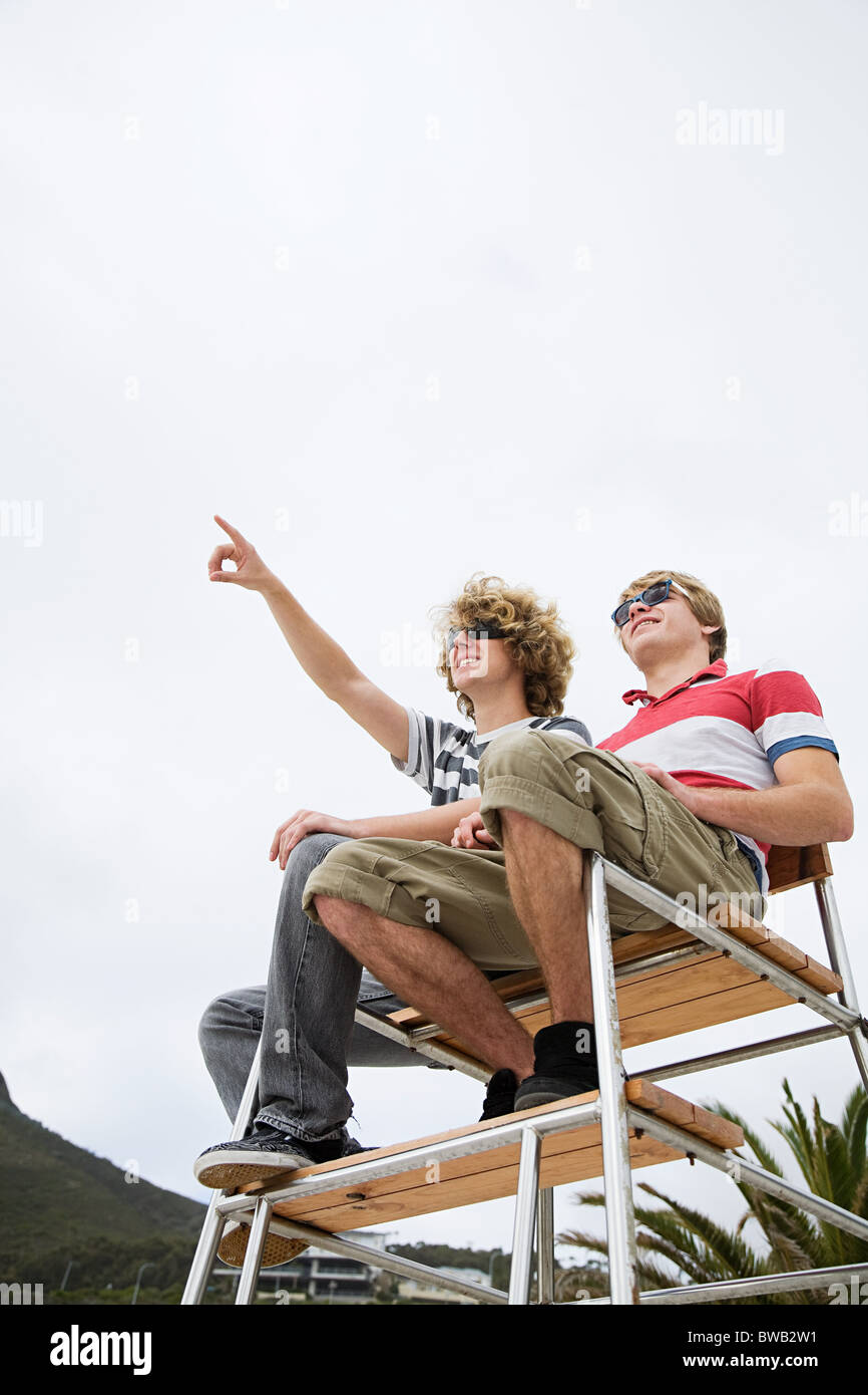 Two boys on lifeguard tower - Stock Image