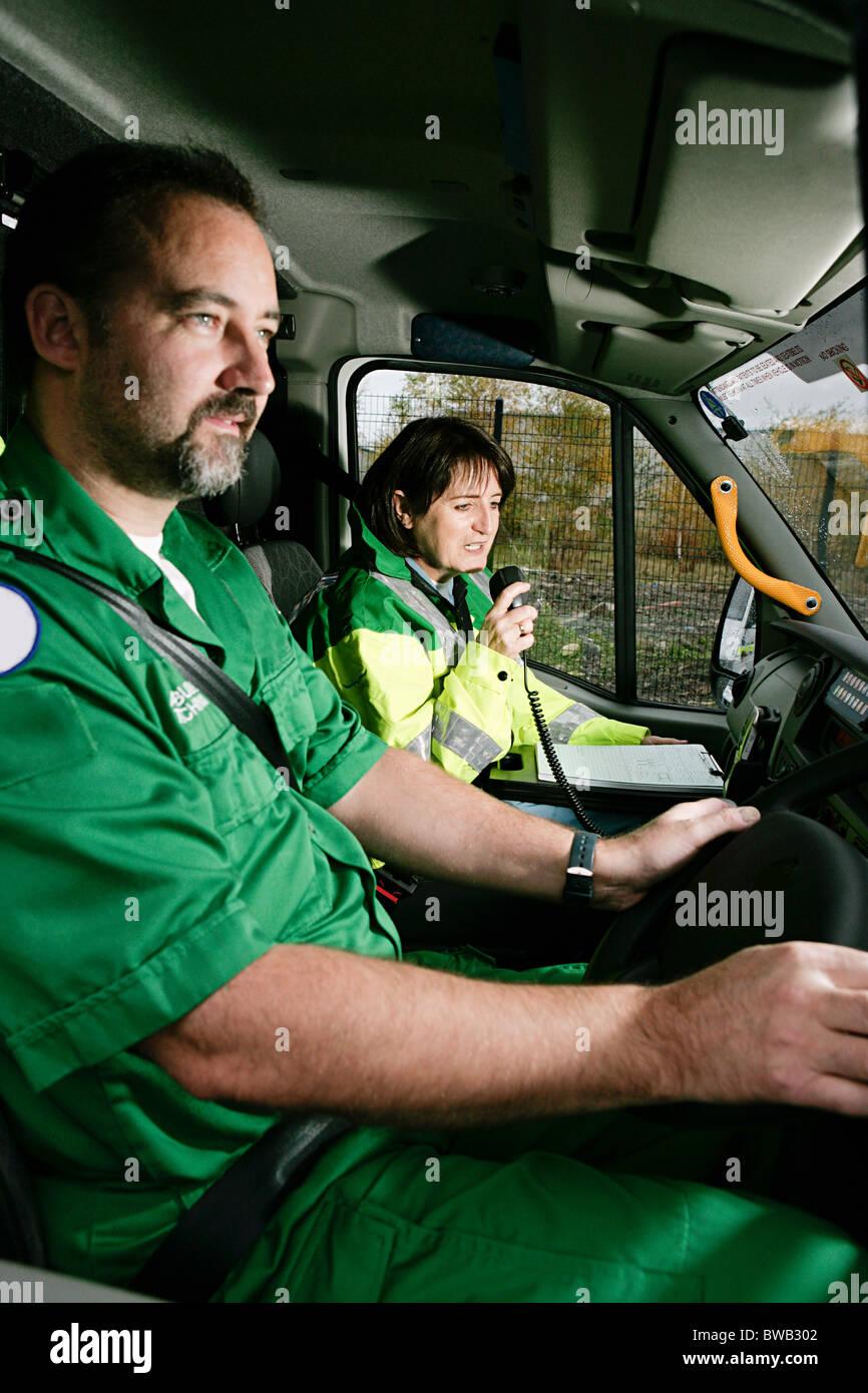 Driver and radio operator in ambulance - Stock Image