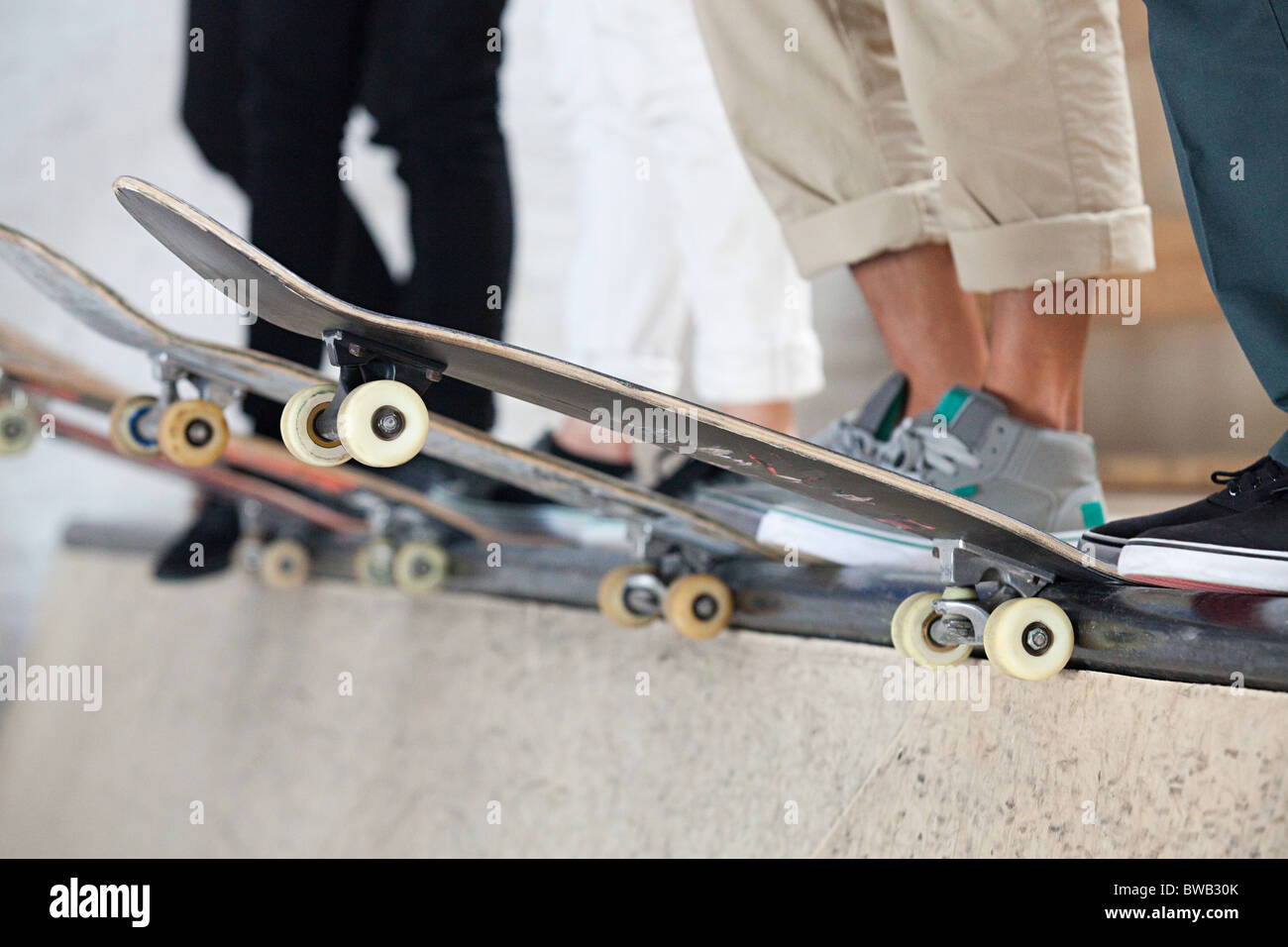 Skaters and their boards - Stock Image