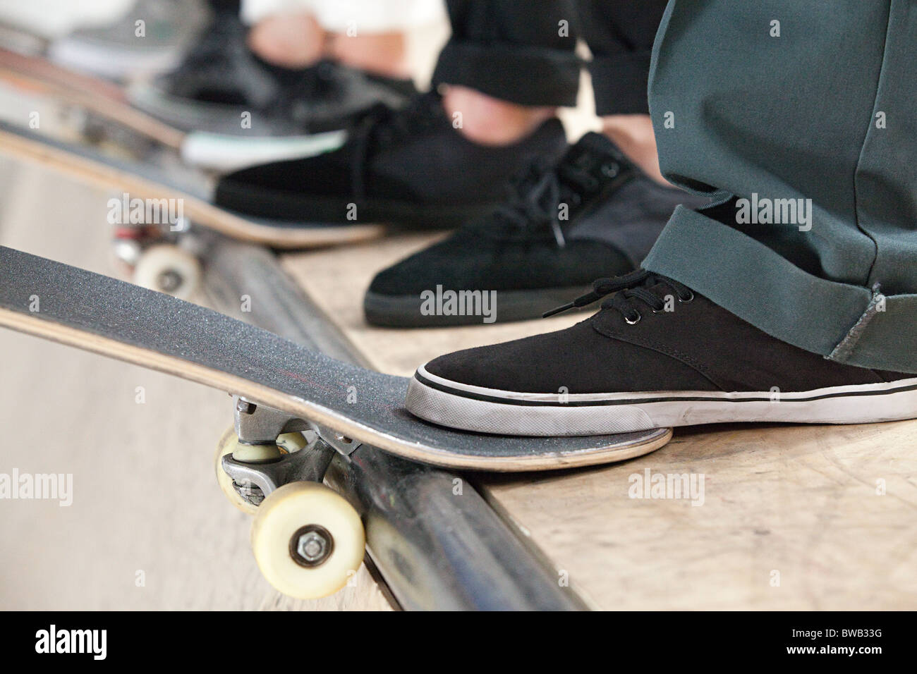 Feet of skaters and boards - Stock Image