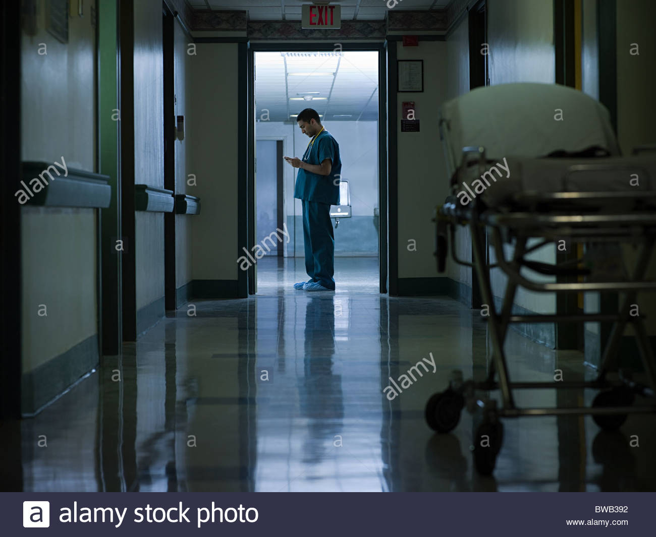 Male doctor in hospital corridor - Stock Image