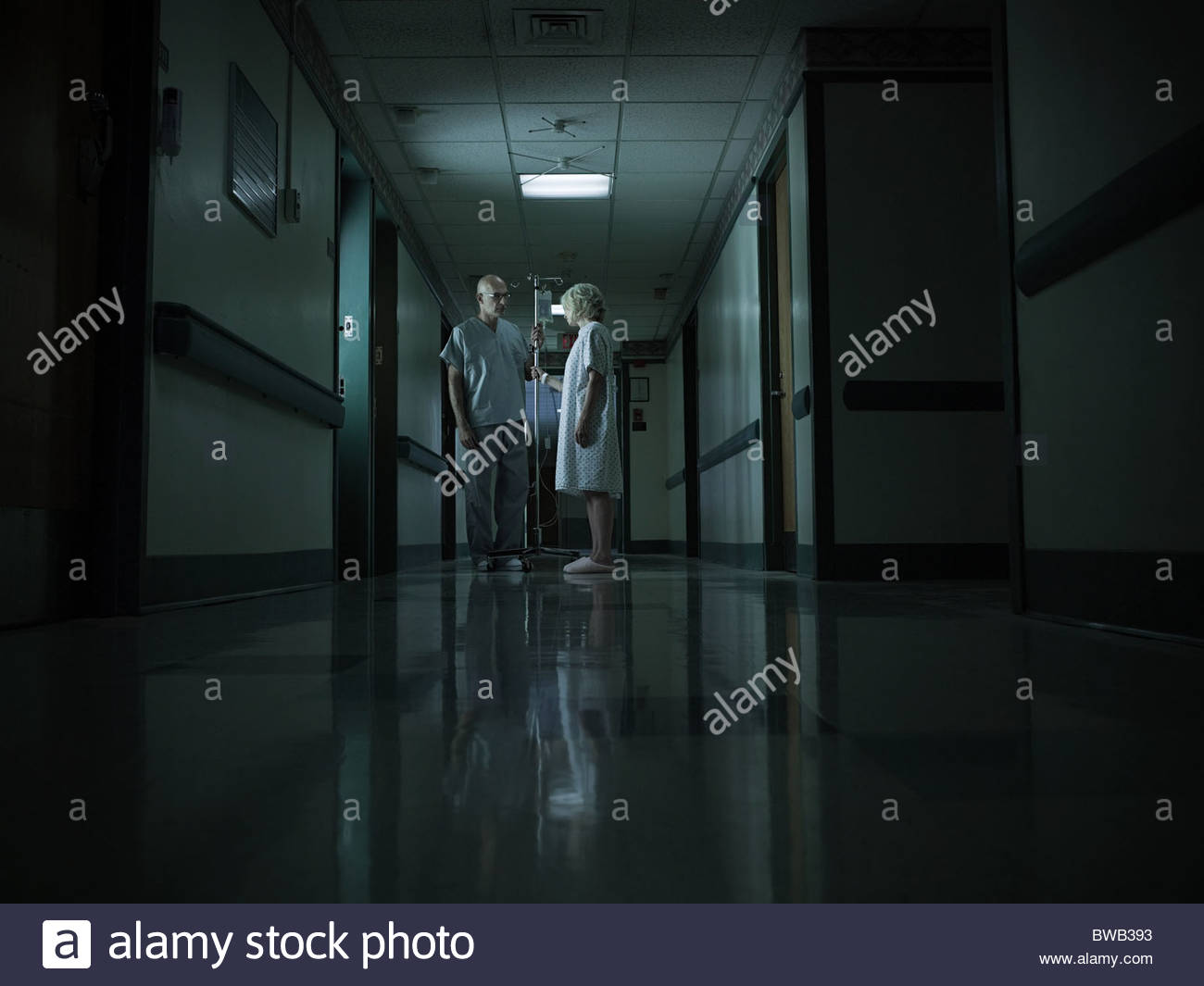 Female patient with intravenous drip - Stock Image