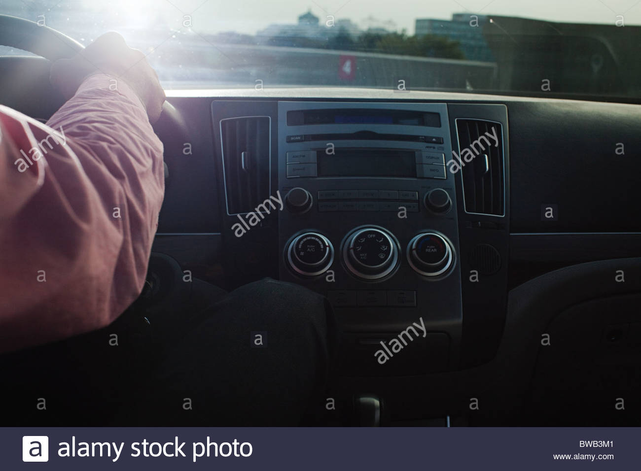 Businessman driving car - Stock Image