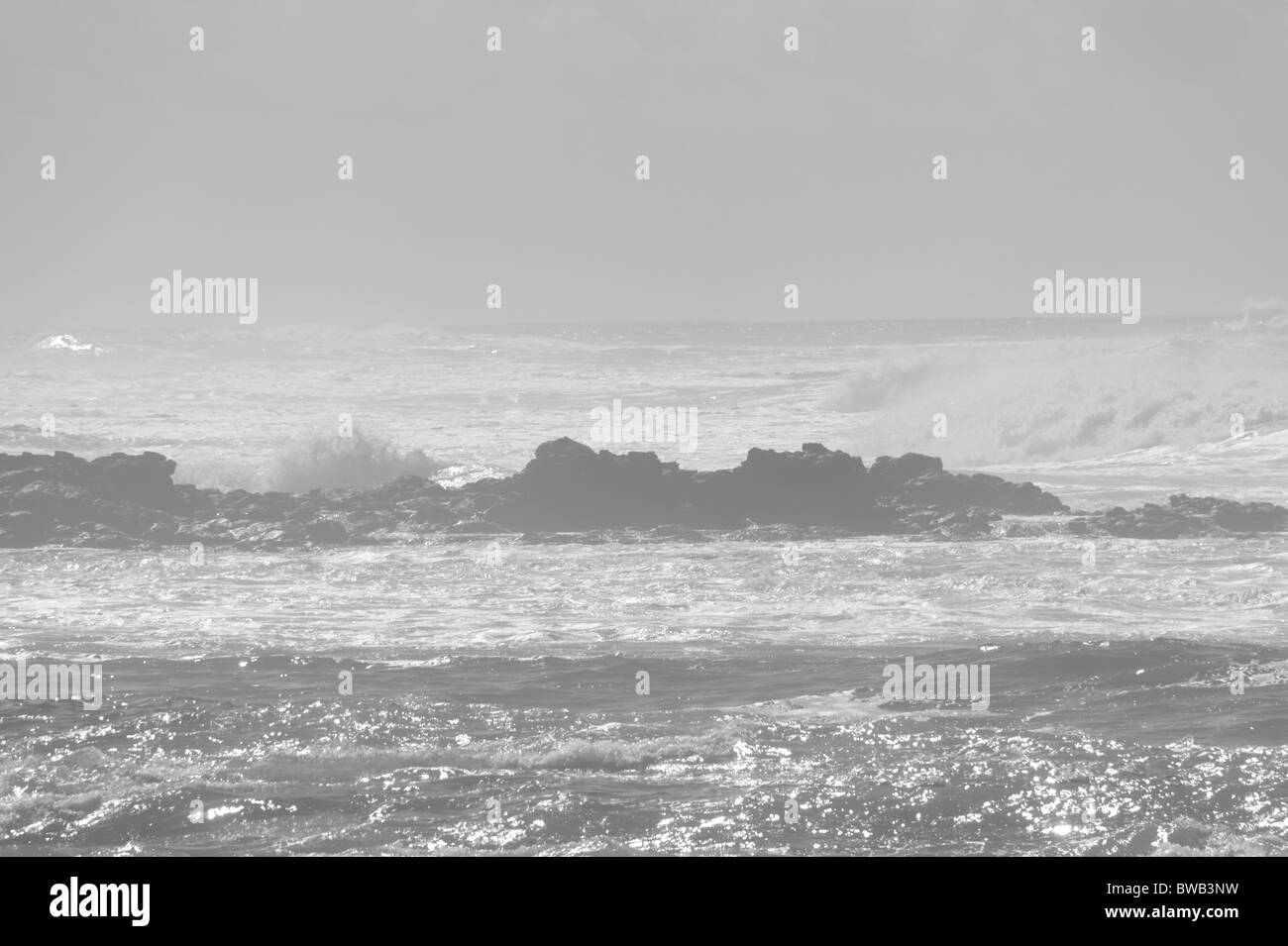 Fuerteventura, Canary Islands - shore and waves. Misty faint background image. - Stock Image