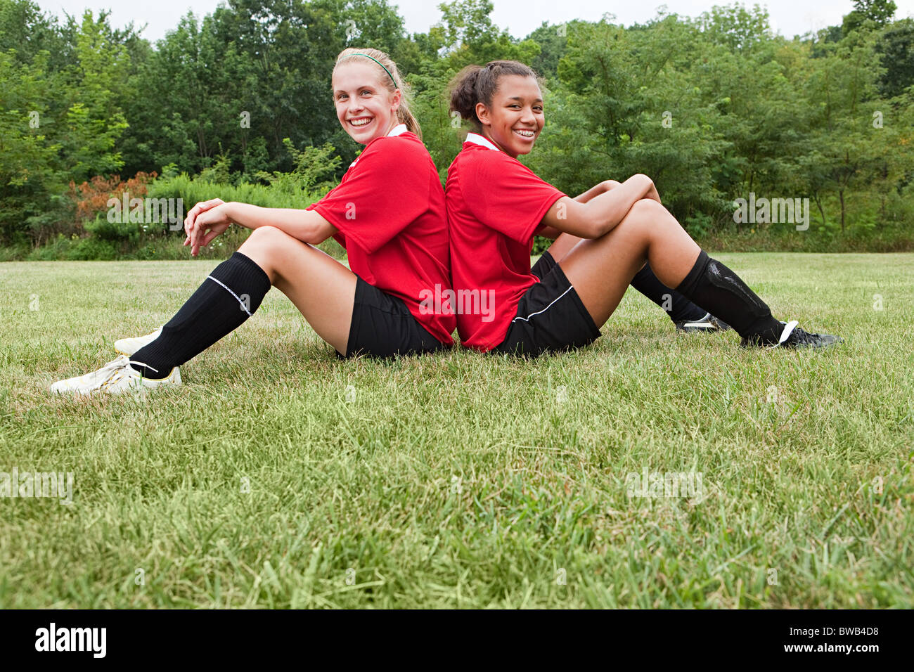 Girl soccer players back to back - Stock Image