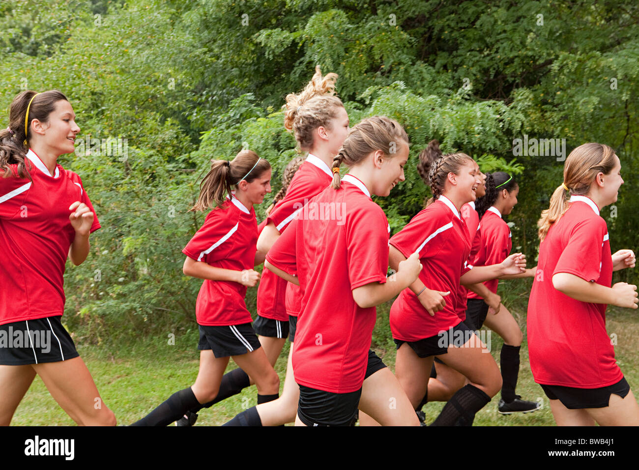 Girl soccer players running - Stock Image