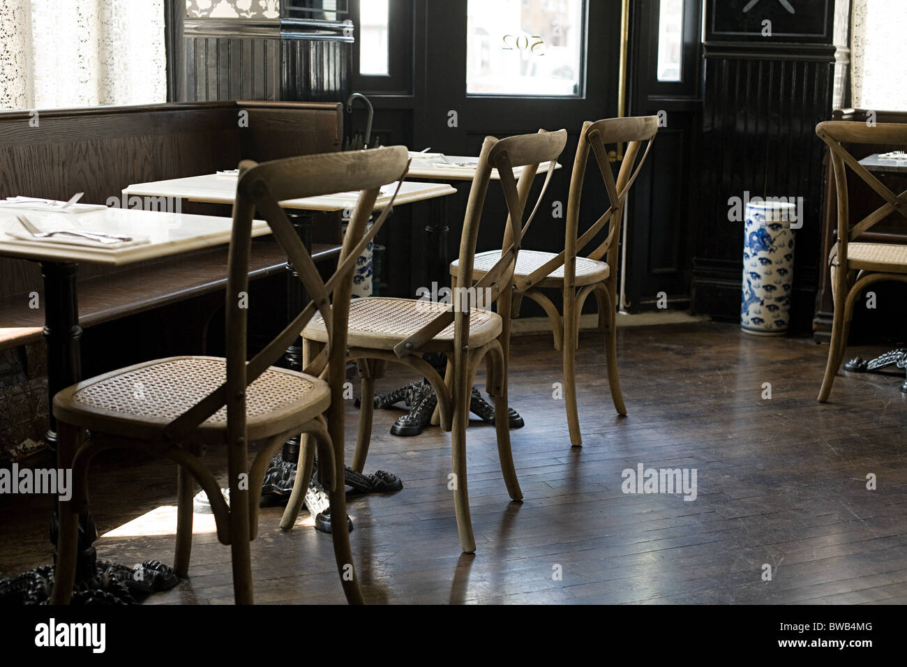Chairs and tables in empty cafe - Stock Image