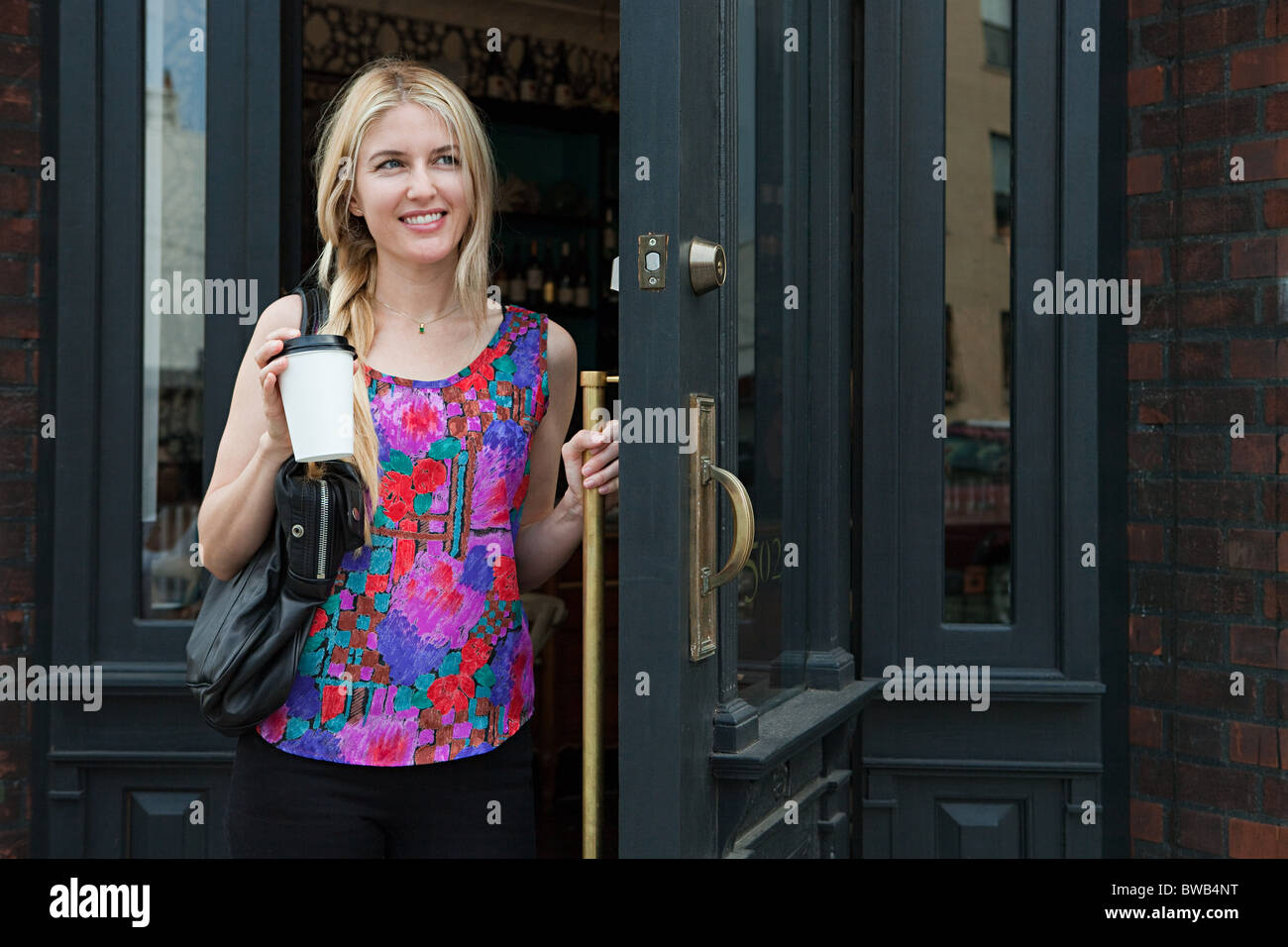 Woman with coffee to go - Stock Image