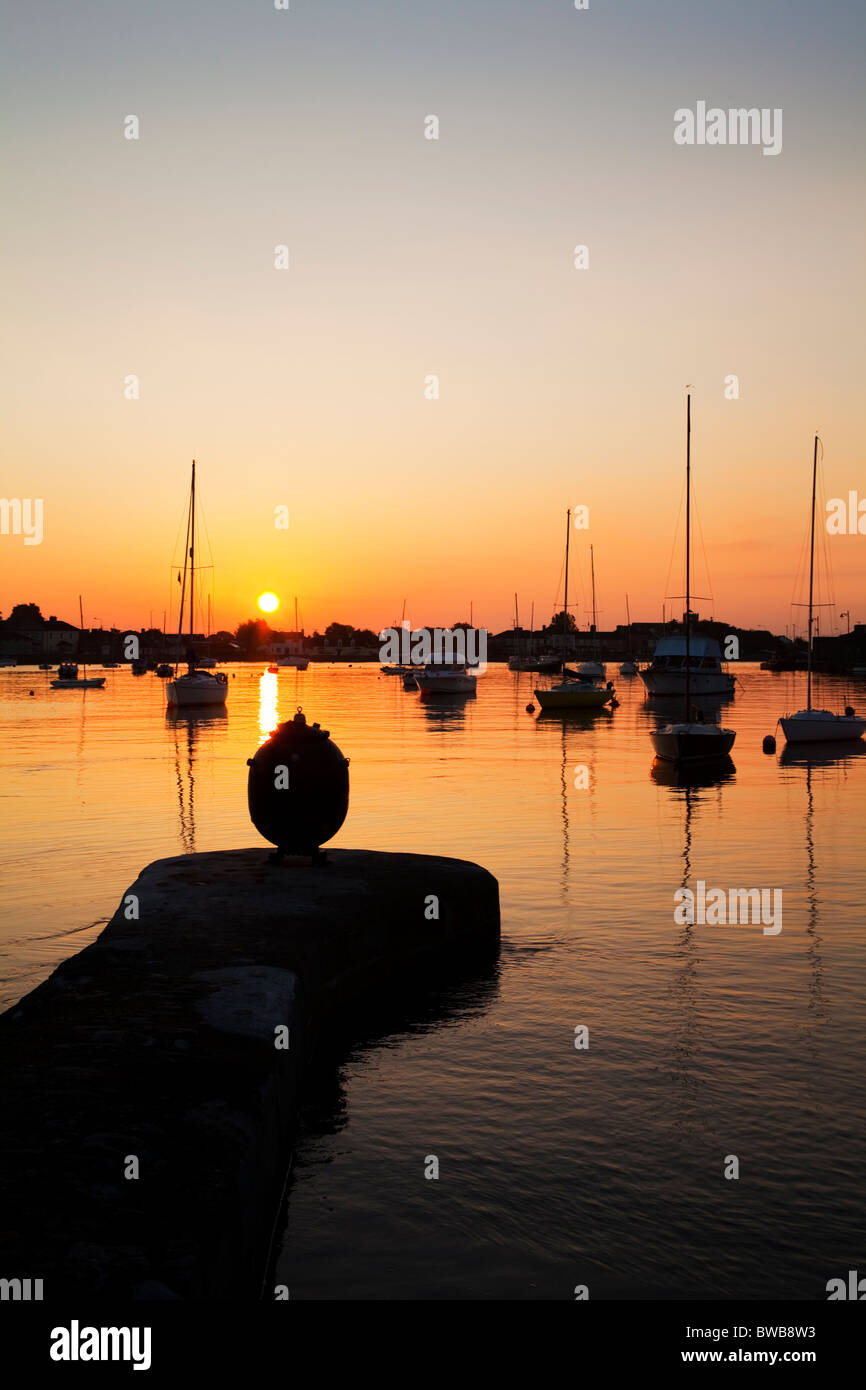 Silhouetted Sea Mine and Yachts, Dungarvan Harbour, County Waterford, Ireland - Stock Image
