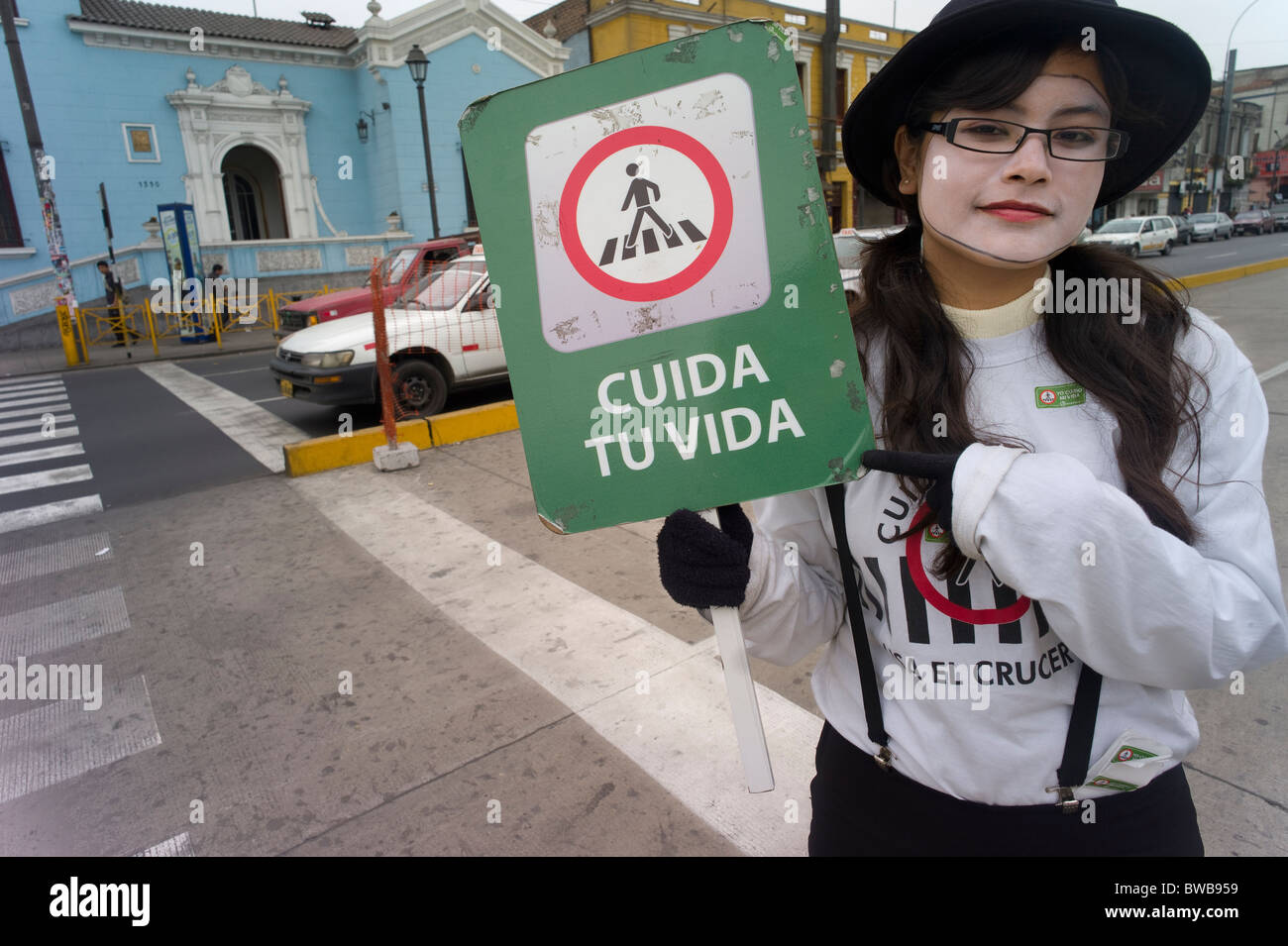 Mime as crossing guard to get people to only go with the light, Lima, Peru Stock Photo