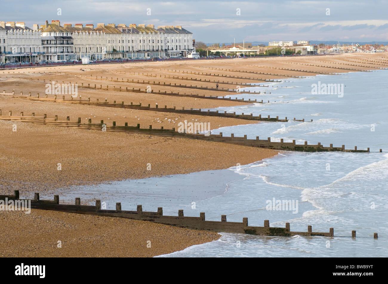 breakwater breakwaters break water waters groins hastings beach east sussex uk pebble pebbles pebbley beach beaches - Stock Image