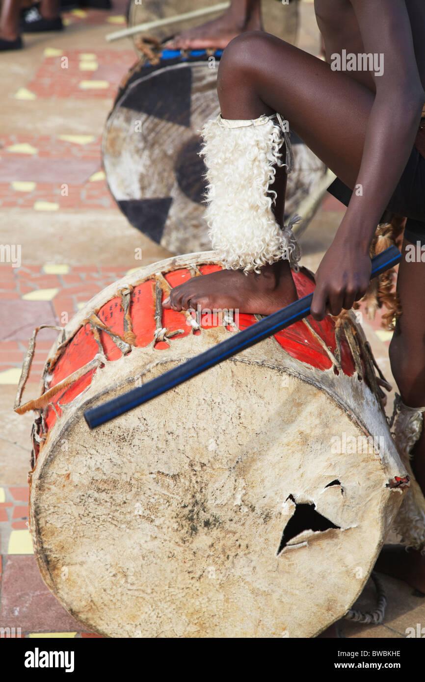 Boy playing drum in traditional Zulu dance at uShaka Marine World, Durban, KwaZulu-Natal, South Africa Stock Photo