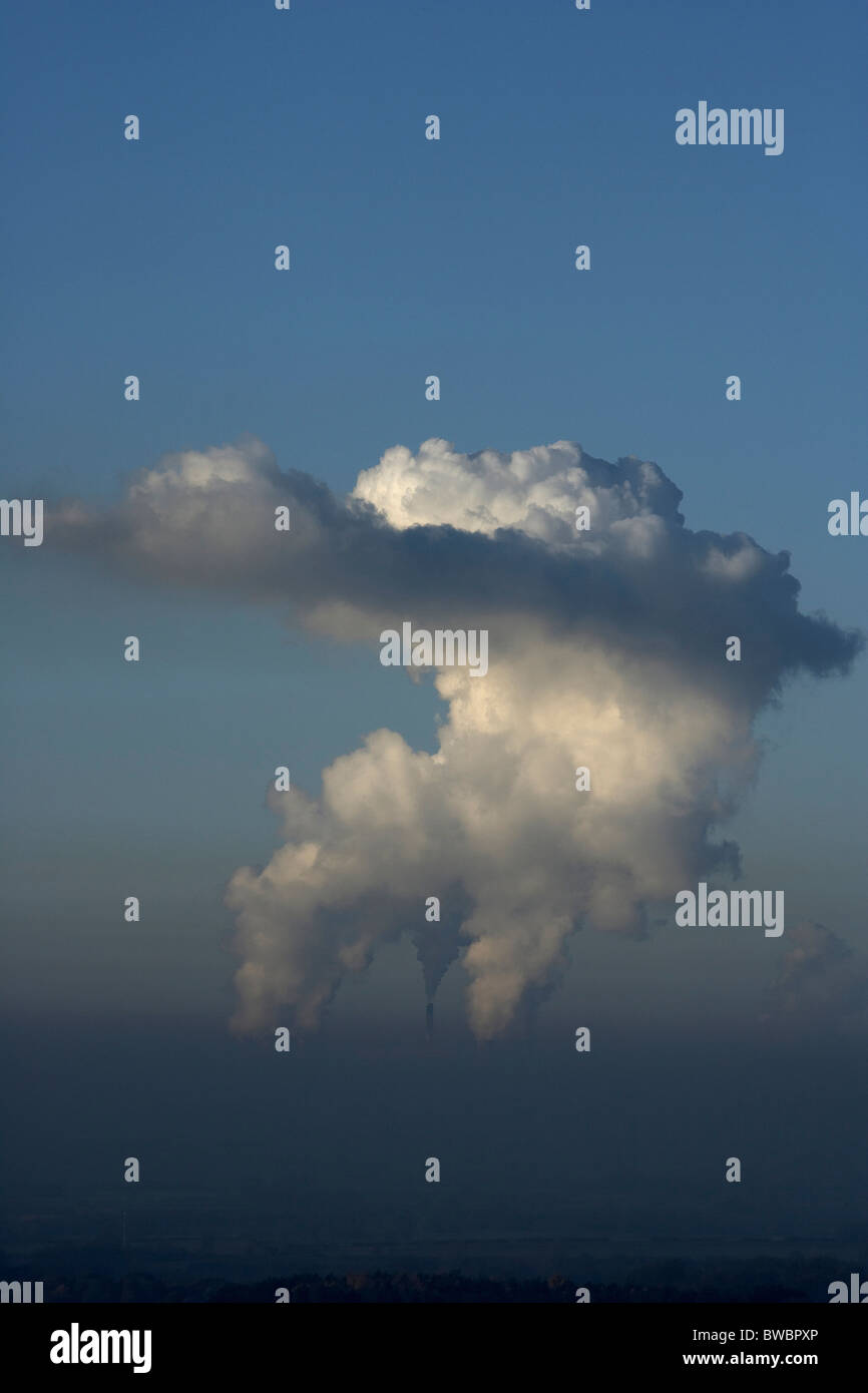 Giant steam clouds rising from the cooling towers at Drax coal fired power station, Selby, Yorkshire, UK. Stock Photo