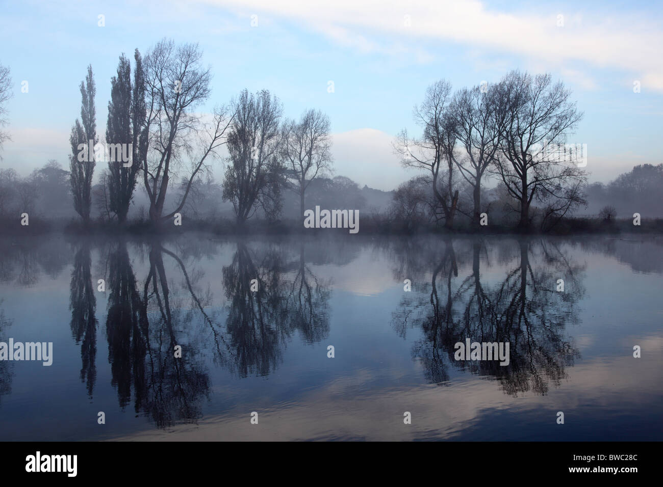 Early morning view across the River Thames from Kew Gardens looking towards Syon House, Richmond-on-Thames, London. - Stock Image